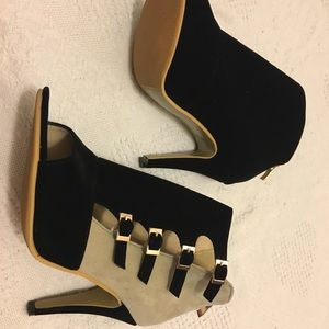 Black and Tan buckled high heel shoes.